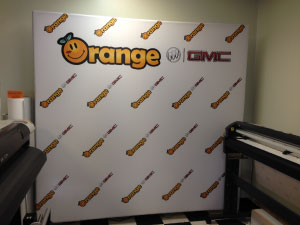 Step and Repeat Backdrop display for Orange Buick GMC